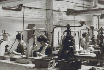 The inside of the Compact Factory, with women at work, 1950s.