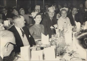 A colleagues retirement party, Susie centre wearing a necklace, c.1950