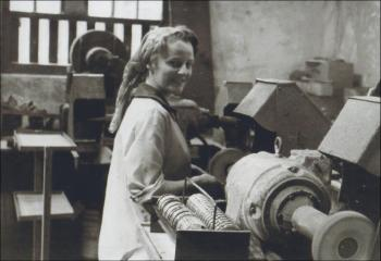 Megan having a go on the polishing machine, 1950s, © Dafydd Llewelyn