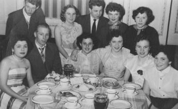 Horrocks workers at a dinner dance in the Connaught Rooms, 1955. Rita is on the right