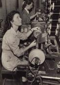 Marge Evans sitting at her coil-making machine - the 'Westminster' - at Sobells Factory
