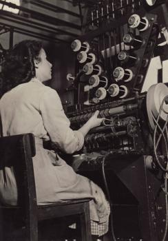 Marge Evans at her coil making machine - the 'Westminster' - at Sobells Factory